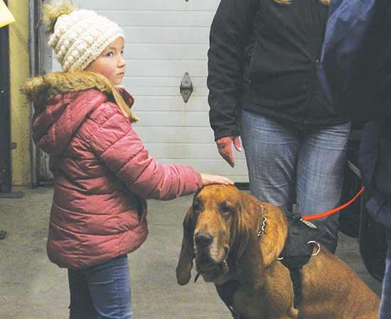 The Buffalo Police Department hosted its open house on Saturday, Oct. 12, where working dogs from Minnesota Canine Search Rescue and Tracking were on site. Above, Emma Fobbe, of Buffalo, gently thanks working dog Bleu for all his service. (Photo by...