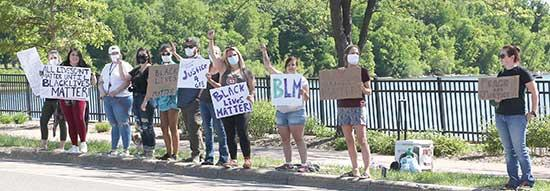 A group of protestors showed their support for George Floyd and Black Lives Matter along the sidewalk on Lake Blvd. S. near Sturges Park in Buffalo.The protests started around 10 a.m. on Saturday, May 30 and lasted throughout the day. Around 75...