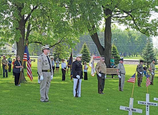 The American Legion Post 305 color guard maintains social distancing during the Memorial Day ceremony in Waverly. In the rear can be seen a few people who attended the brief program, though the public had not been invited this year due to the COVID-...